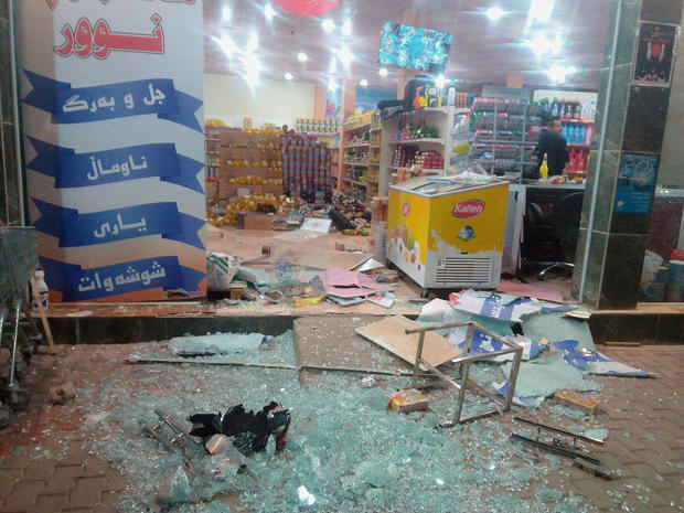 A damaged storefront is seen after an earthquake in Halabja, Iraq
