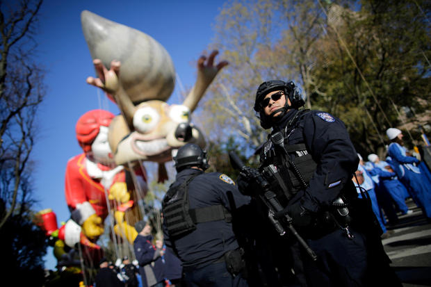New York Police Officers stand guard during the 91st Macy's Thanksgiving Day Parade in the Manhattan borough of New York City