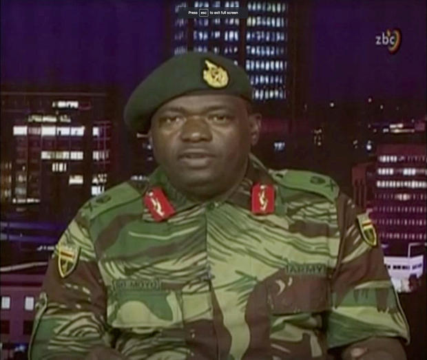 Zimbabwe Defence Forces Major-General Moyo makes an announcement on state broadcaster ZBC