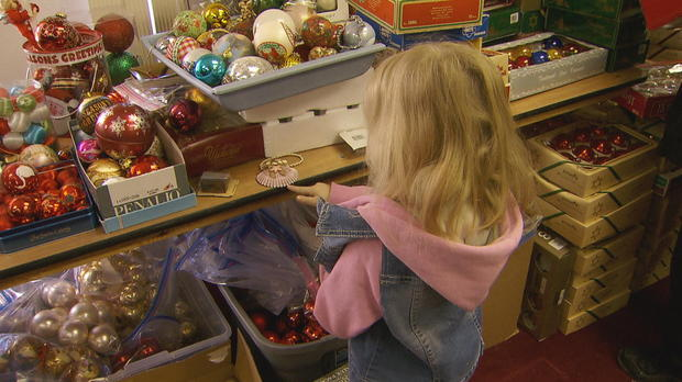 a-little-girl-chooses-ornaments-at-the-annual-christmas-tree-project-giveaway-credit-cbs-news.jpg