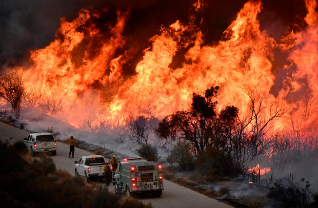Fire fighters attack the Thomas Fire's north flank with backfires as they continue to fight a massive wildfire north of Los Angeles, near Ojai , California